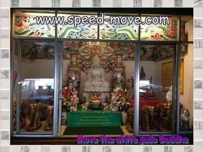 Moving of white jade Buddha image